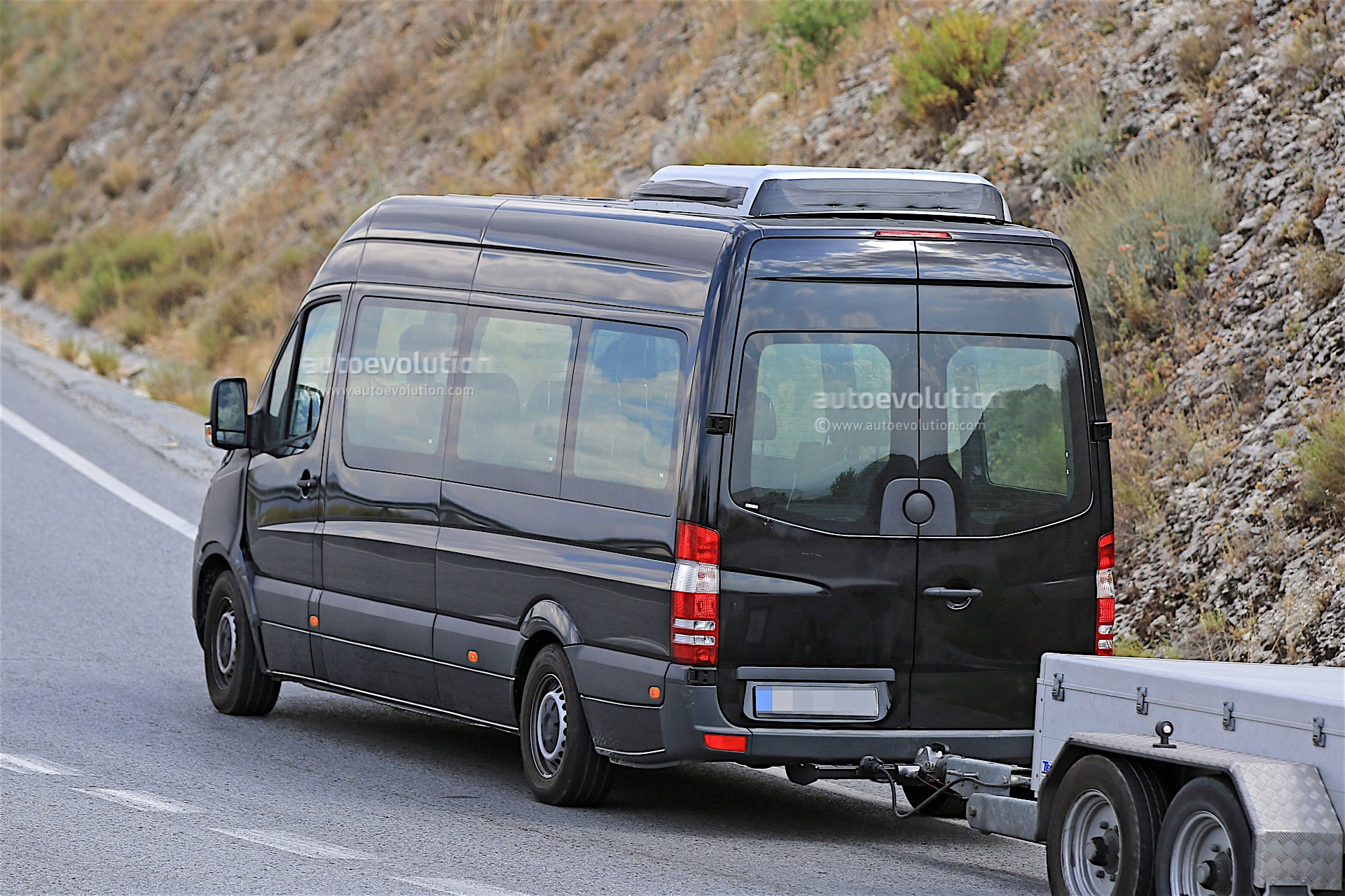 2018 mercedes benz sprinter prototype spotted with thin for Mercedes benz van