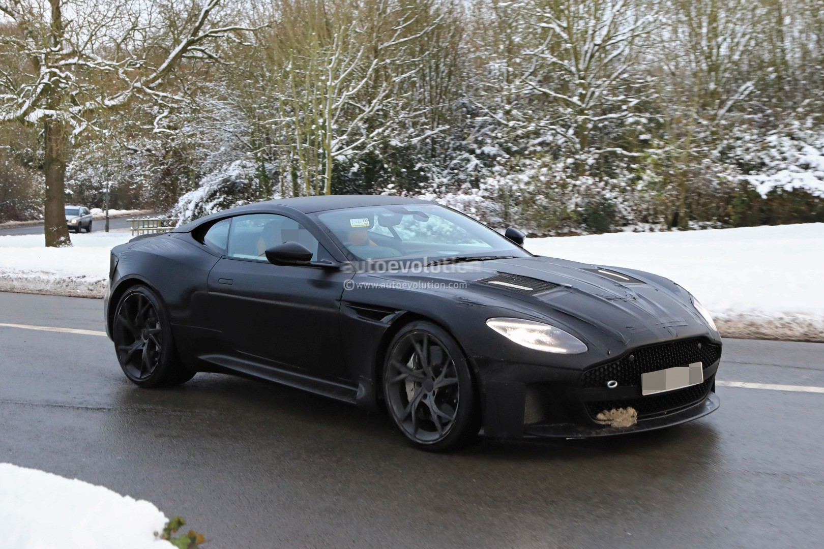 spyshots 2019 aston martin vanquish testing in the snow looks gorgeous autoevolution. Black Bedroom Furniture Sets. Home Design Ideas
