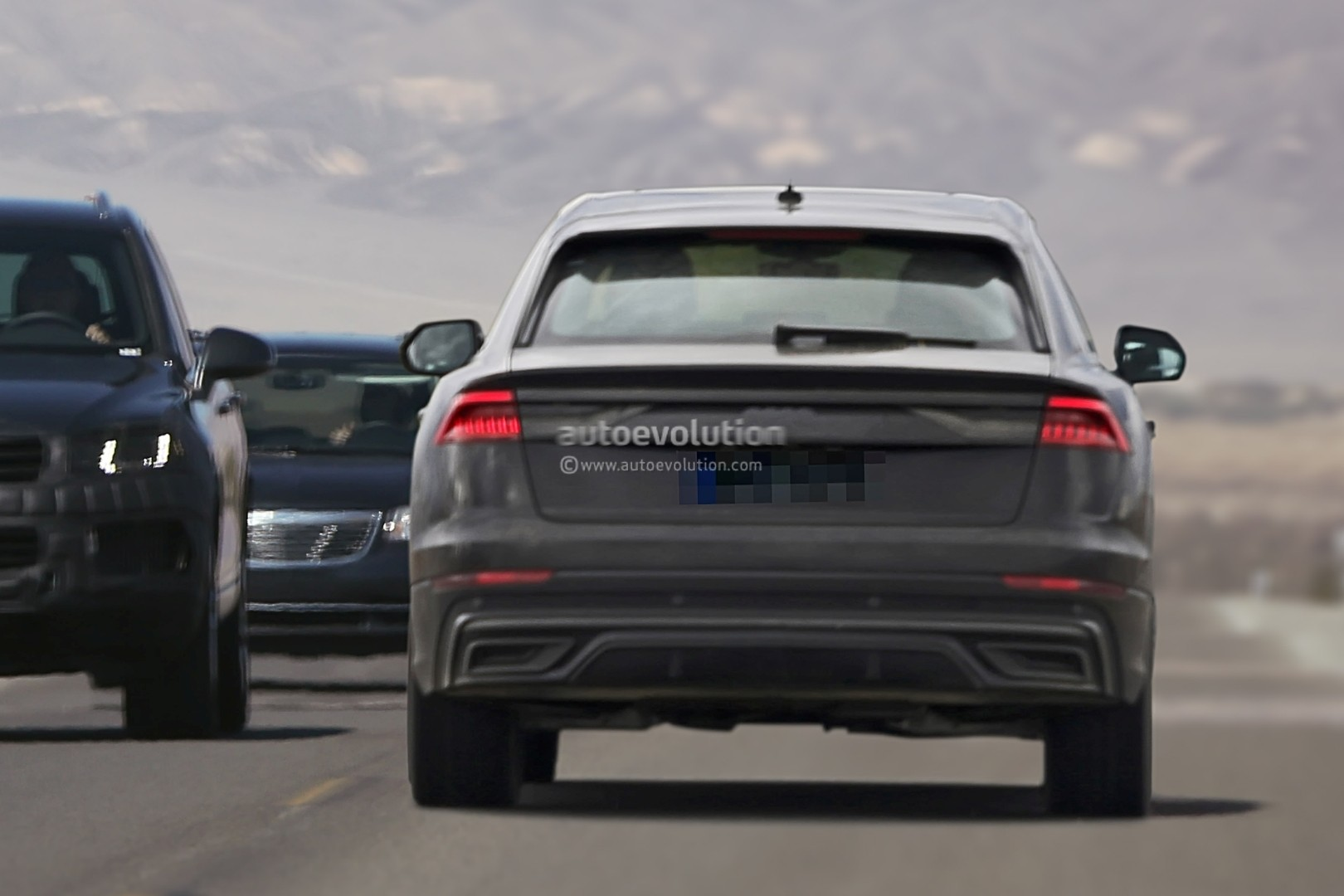 Audi Q Revealed By Production Ready Prototype Has Urus Like Rear End