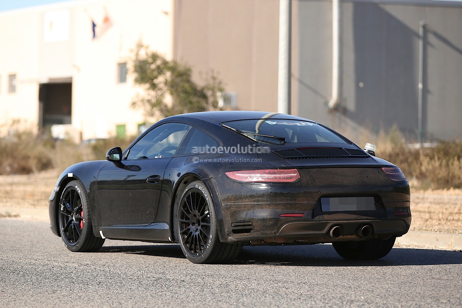 next generation 2019 porsche 911 spied with wider tracks say hello to the hybrid autoevolution. Black Bedroom Furniture Sets. Home Design Ideas