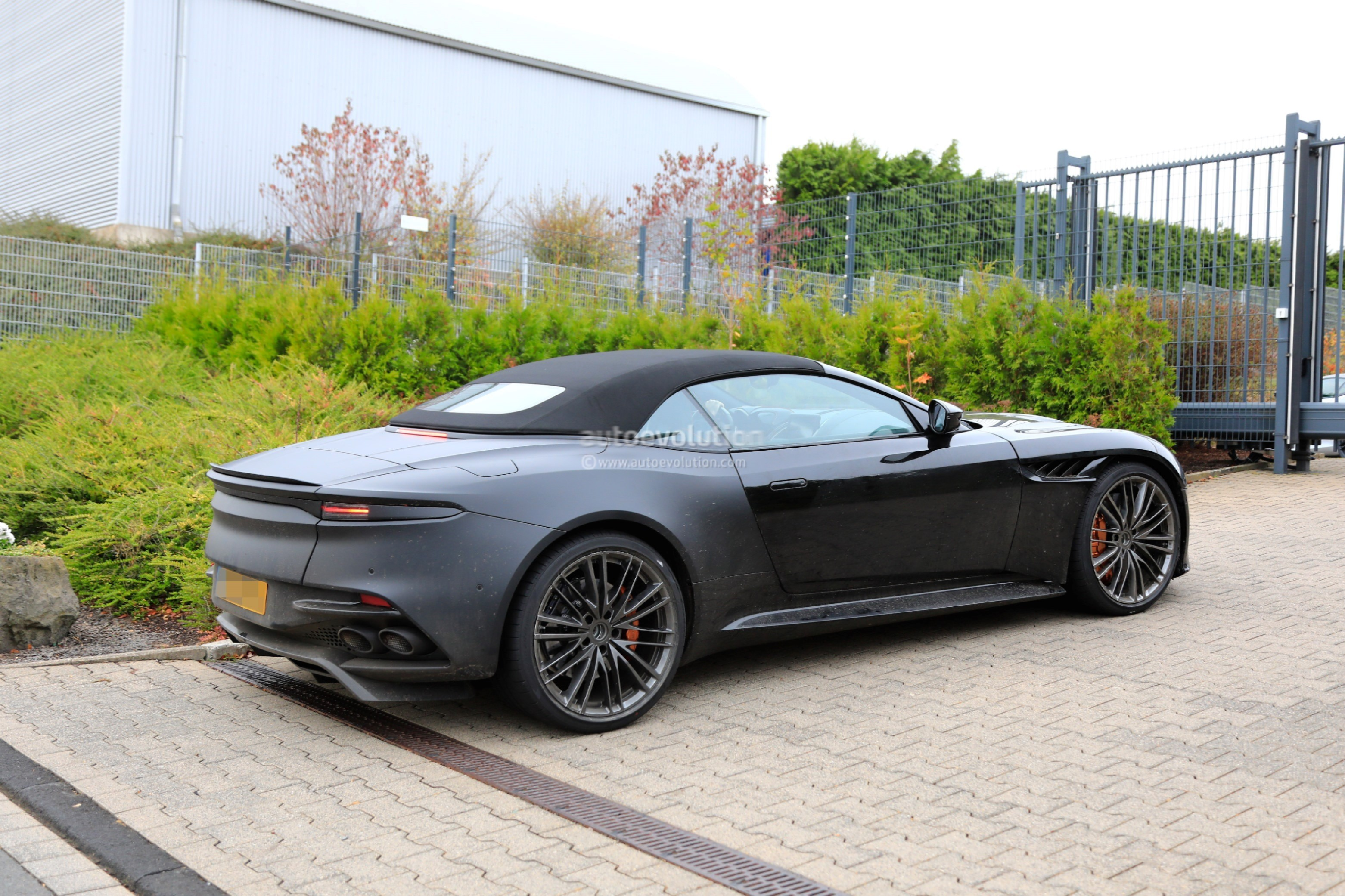 2020 aston martin dbs superleggera volante spied with bronze brake