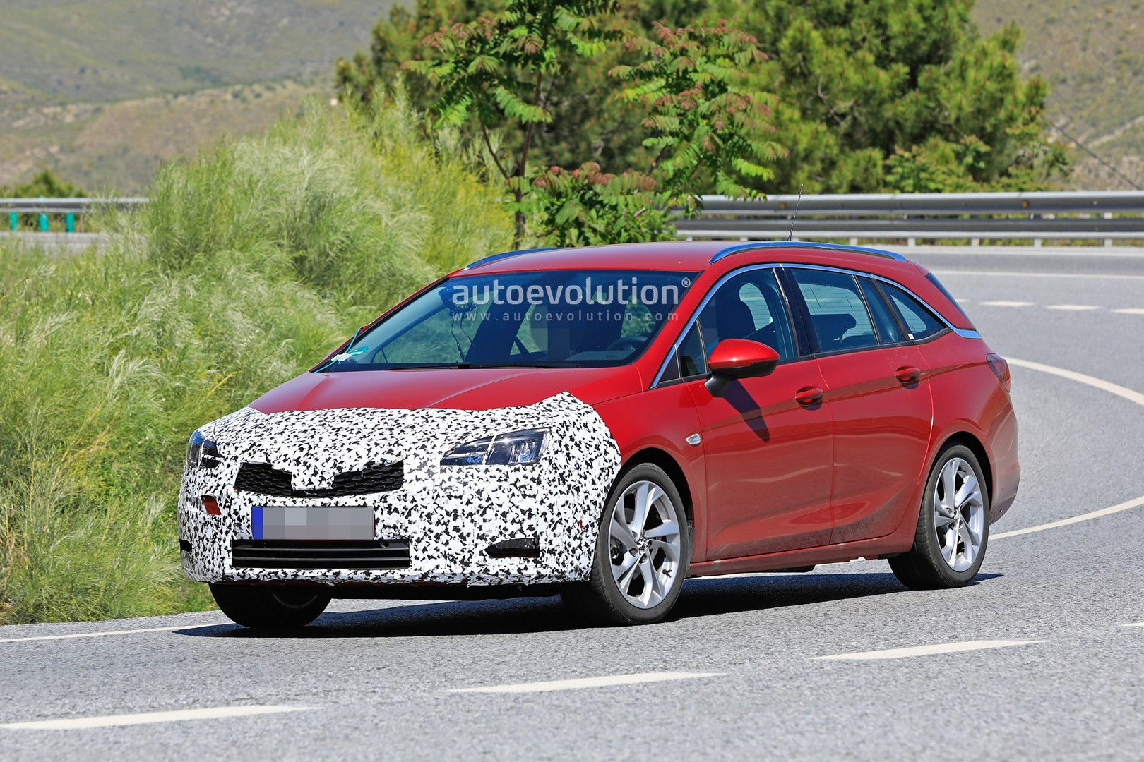 2020 opel astra wagon spied with mild facelift getting