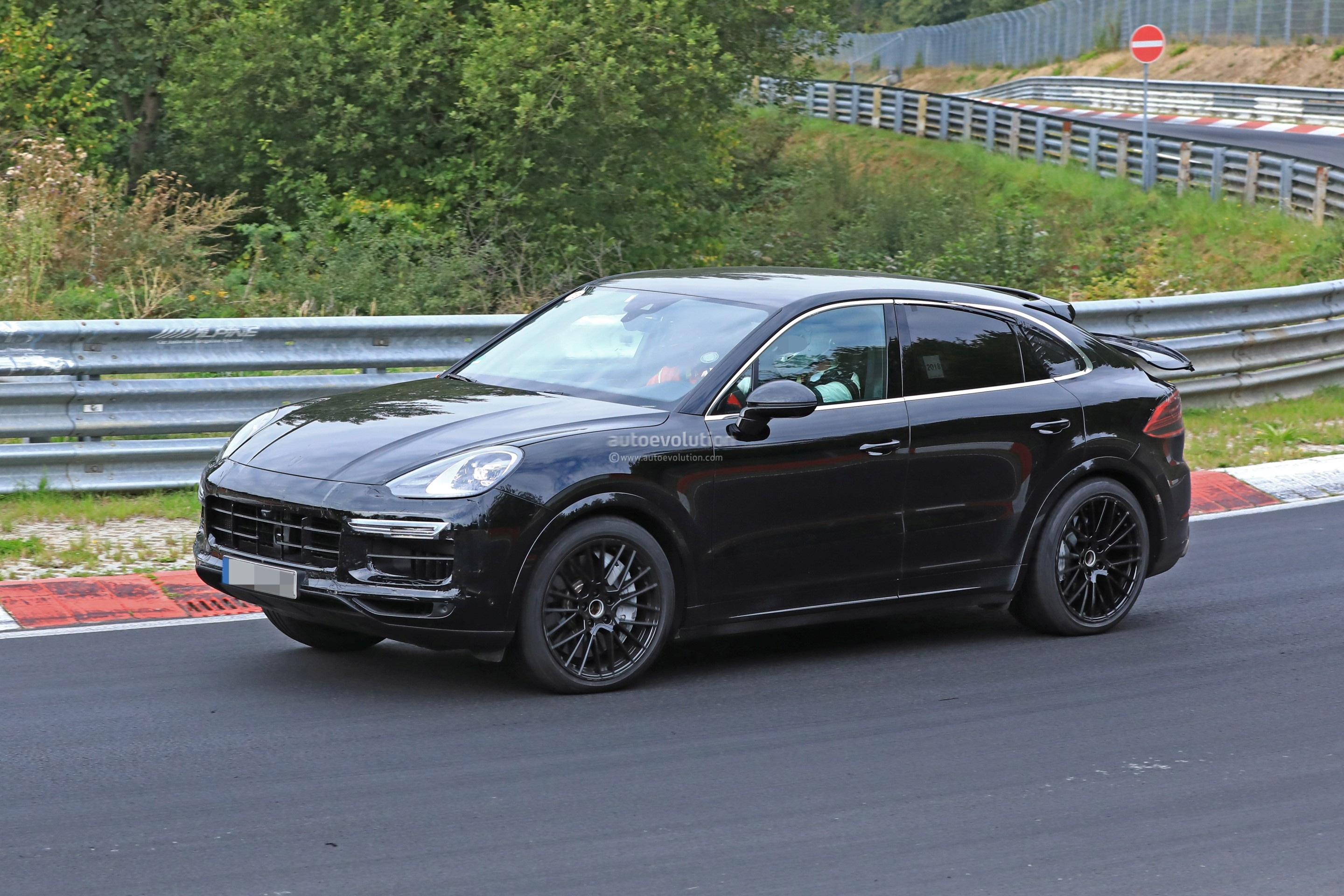 How To Focus On Wet Window >> 2020 Porsche Cayenne Coupe Hits Nurburgring, Prototype Shows Active Rear Wing - autoevolution