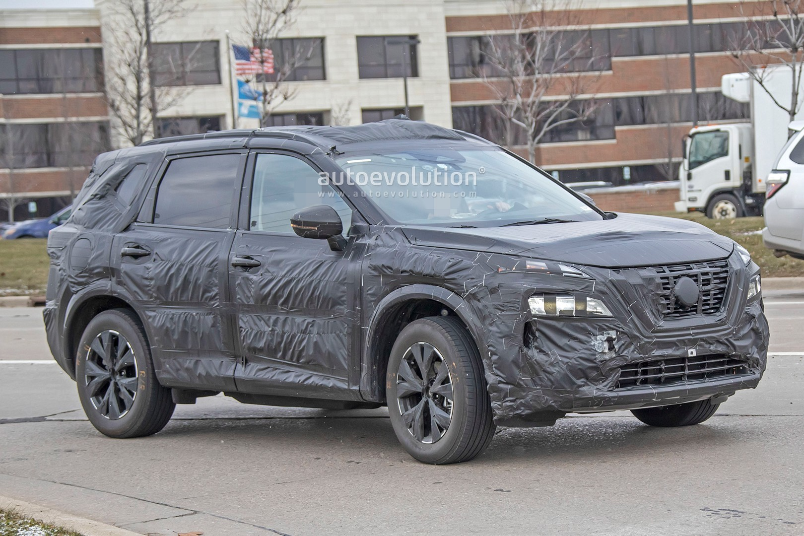 2021 nissan rogue spied with less camo shows digital