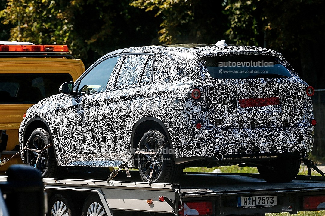 spyshots-bmw-f48-x1-spied-on-a-trailer-720p-5