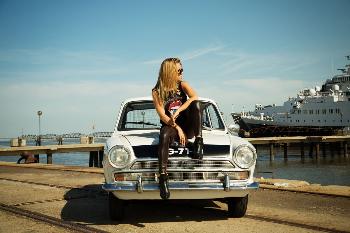 A blond beauty is a rock star in this 1966 ford cortina ad