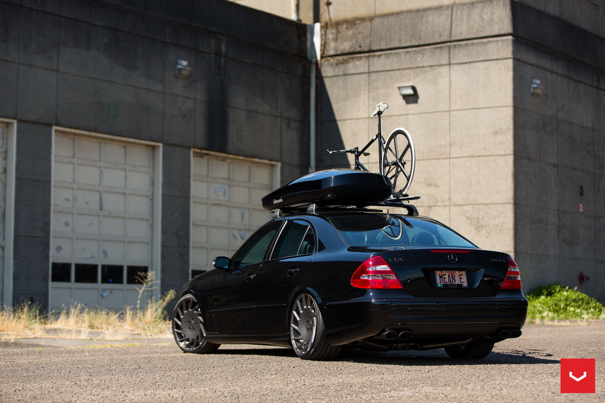 All black mercedes e55 amg rides on vossen wheels carries for Mercedes benz roof box 400