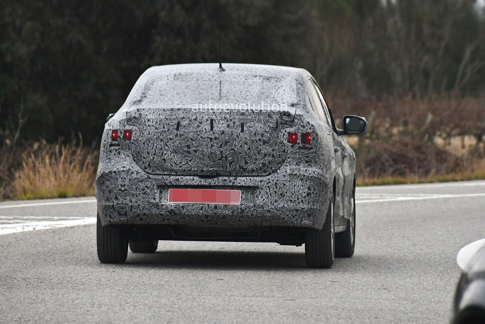 all-new-2021-dacia-logan-spied-with-led-lights-coupe-roof_11