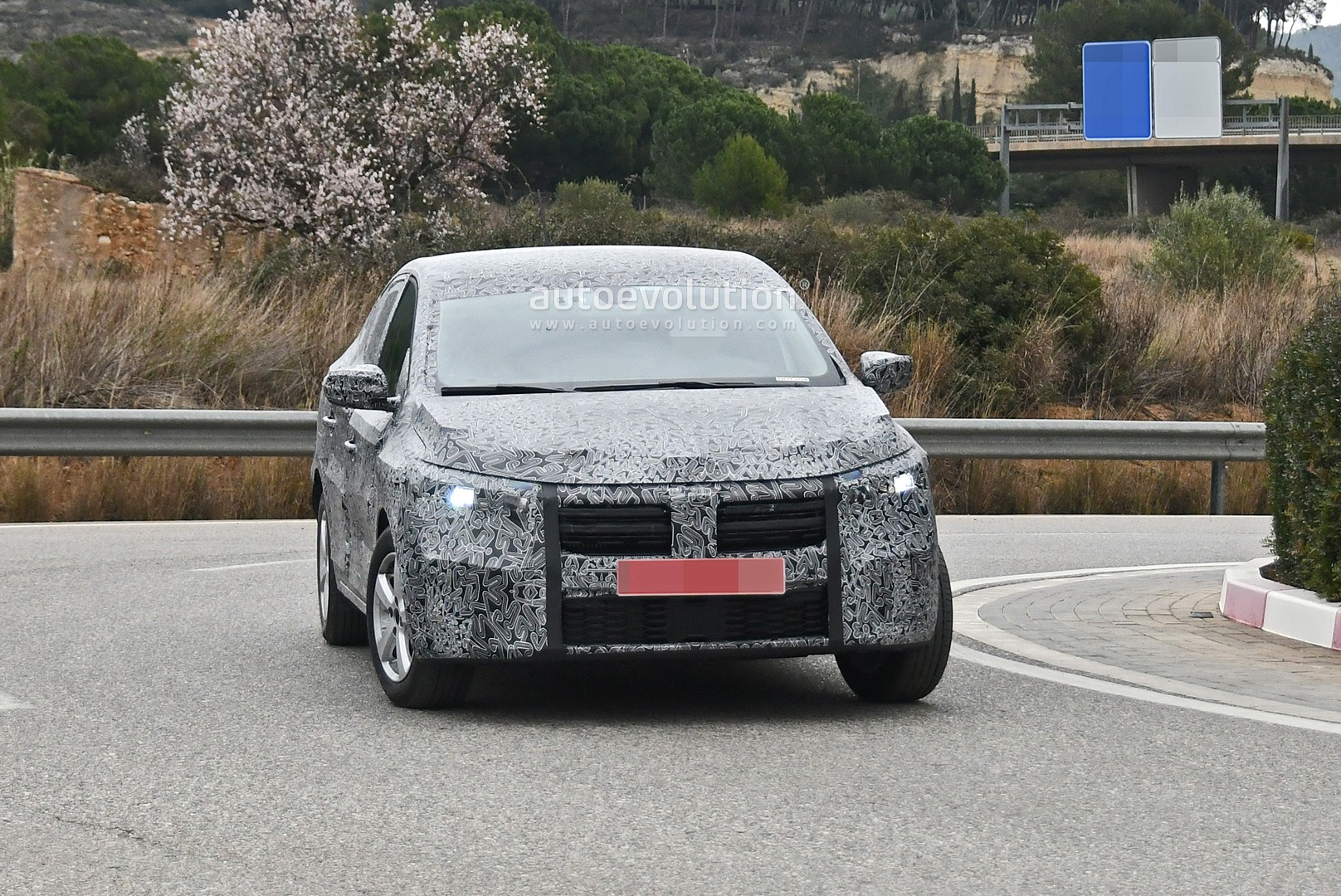 all-new-2021-dacia-logan-spied-with-led-lights-coupe-roof_3