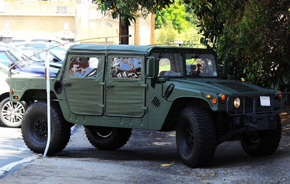 Arnold Schwarzenegger Drives His Green Hummer H1 To Lunch