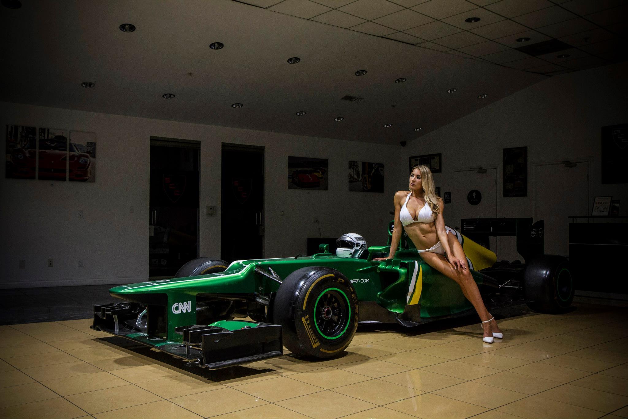 Bikini Blonde Christina Riordan Poses On Caterham Formula