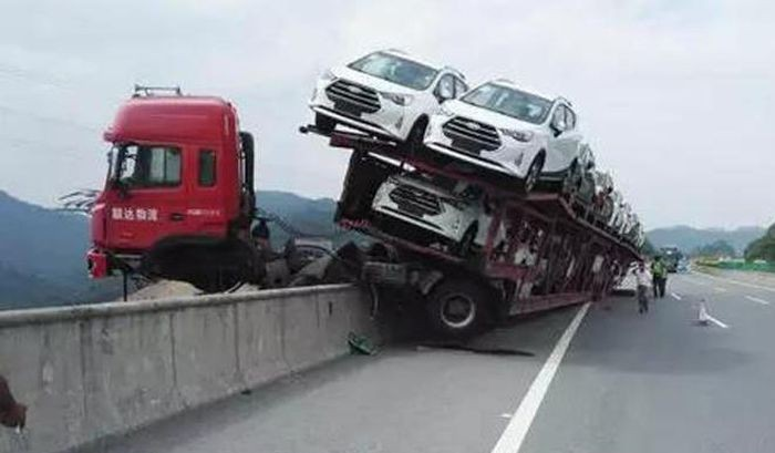 Car Carrier Almost Falls off Bridge in China, Driver Saved ...