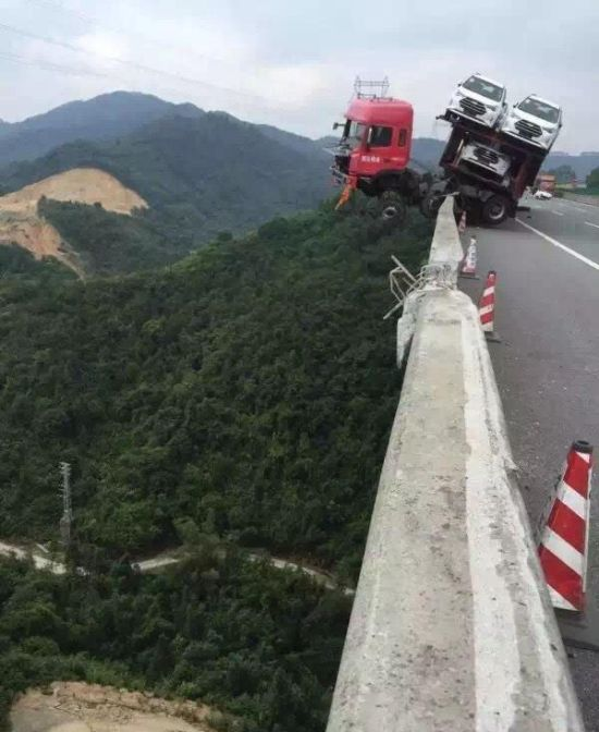 Car Carrier Almost Falls Off Bridge In China Driver Saved