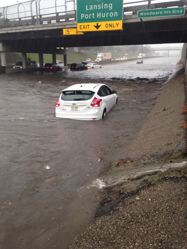 Cars Trudge Through Detroit Flooding Ford Focus St