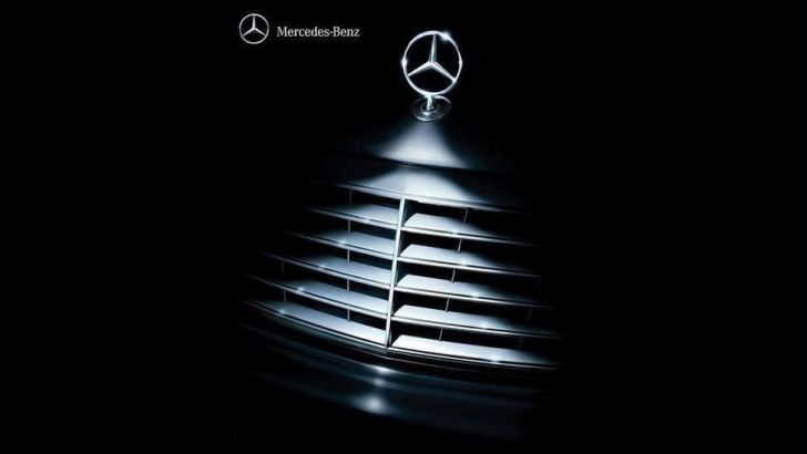 Christmas tree decorated with tons of car logos has for Mercedes benz christmas ornament