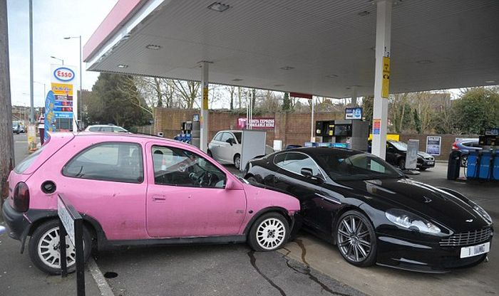cute-pink-corsa-crashes-into-aston-marti