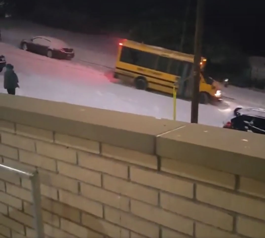 School bus has a cocktail of snow and gravity