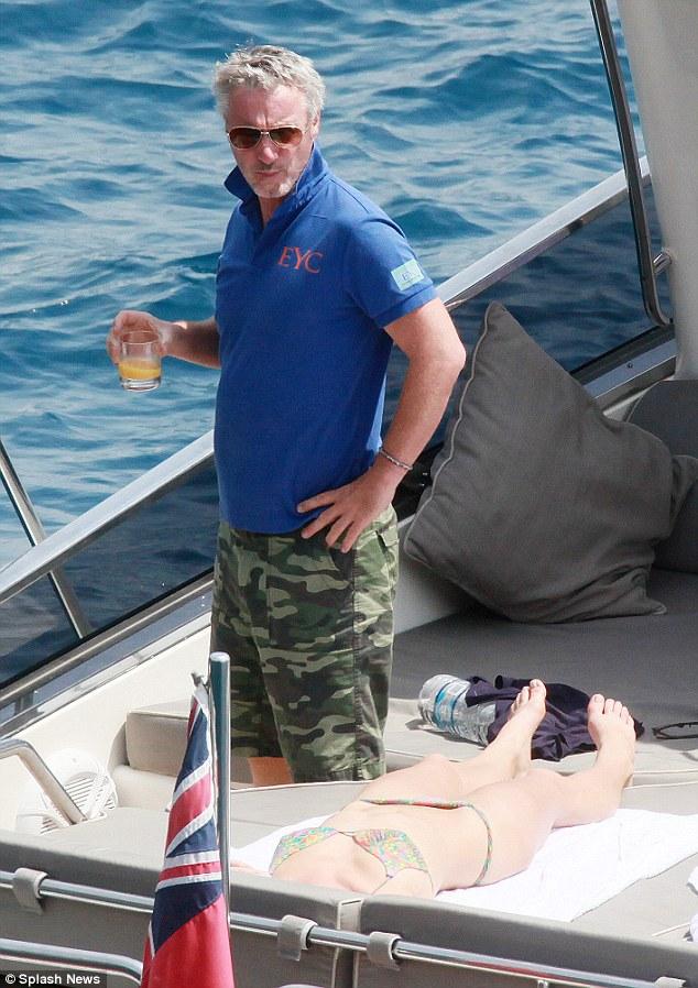 F1 Racer Eddie Irvine Surrounded By Bikini Beauties on His