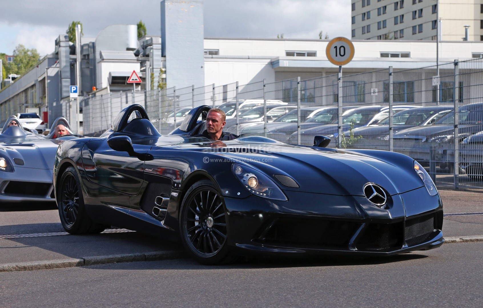 four mercedes-benz slr stirling moss models caught strolling through