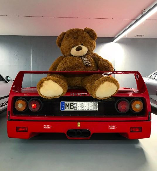 german supercar collector keeps a lucky giant teddy bear