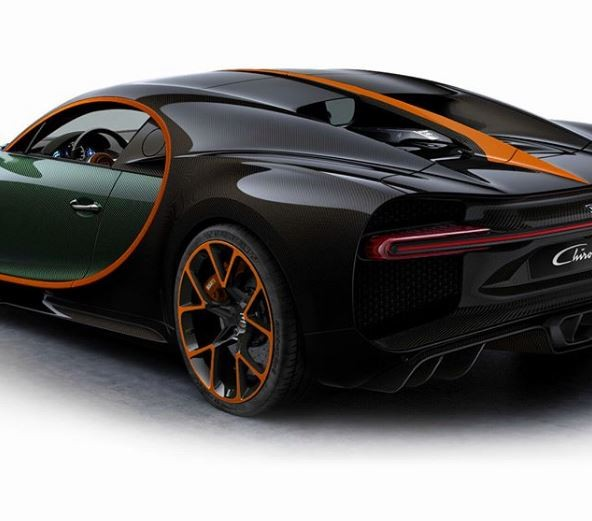 green carbon bugatti chiron with orange details has a polarizing