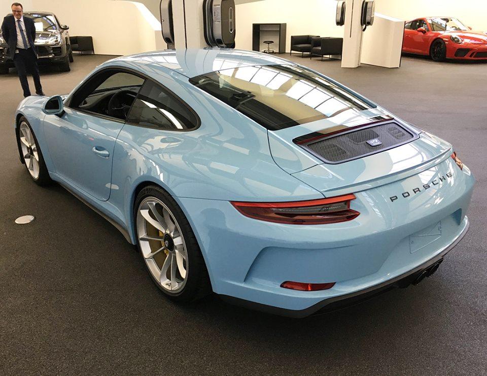 Porsche puts brake on all-electric 911