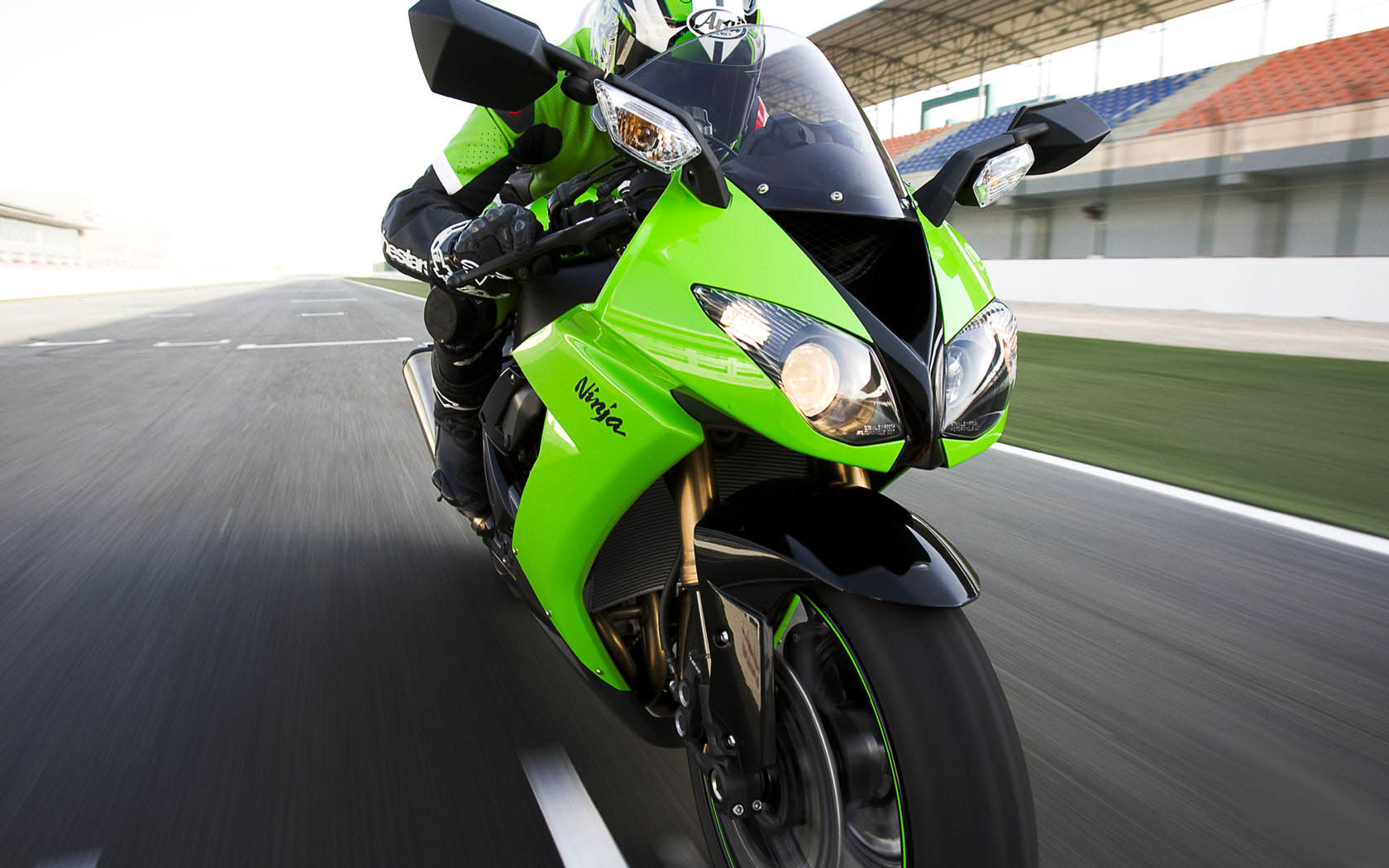 Rider Tucked Behind The Speed Bubble Of A Kawasaki Ninja