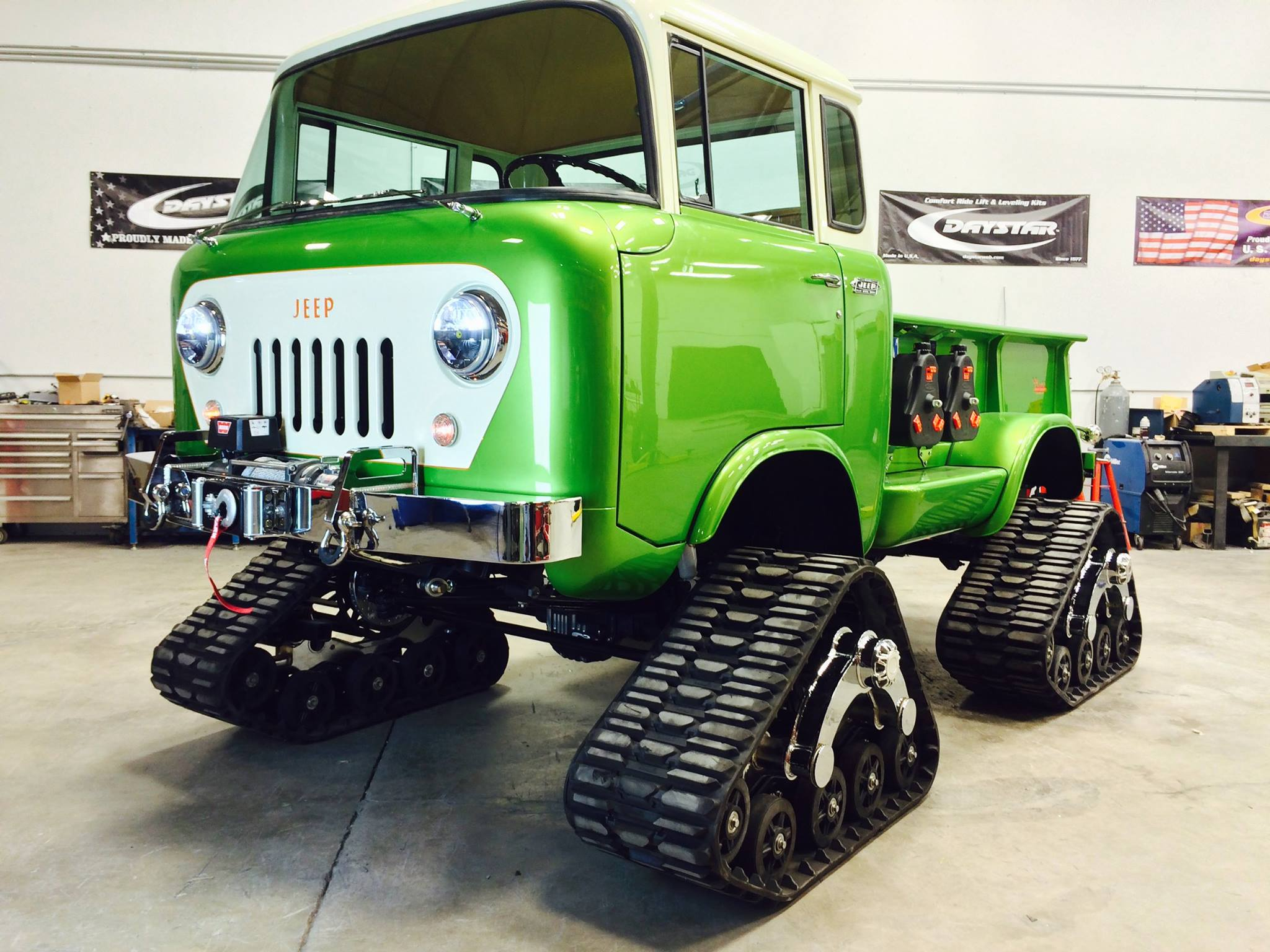 jeep fc 170 pickup has tracks and acid green paint