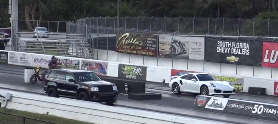 Jeep Grand Cherokee Srt8 Vs Porsche 911 Turbo Drag Race Is