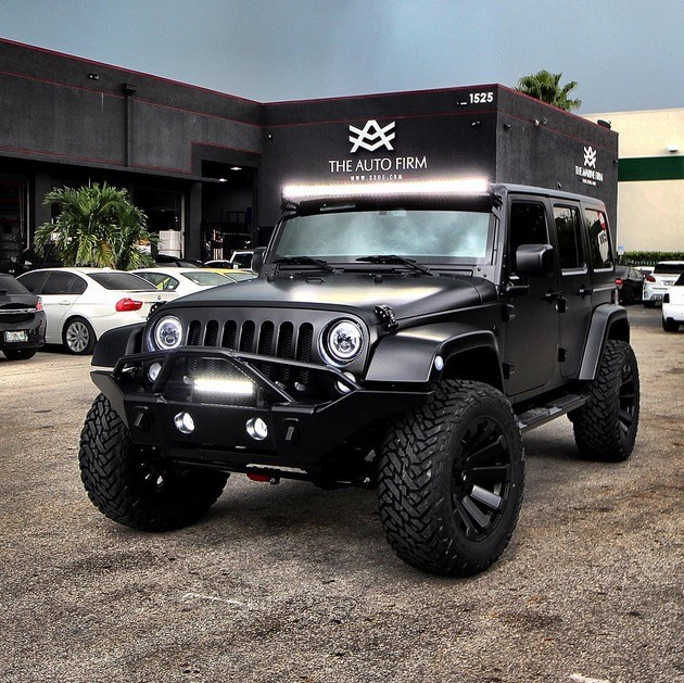 jeep wrangler with satin black cover is a beast in