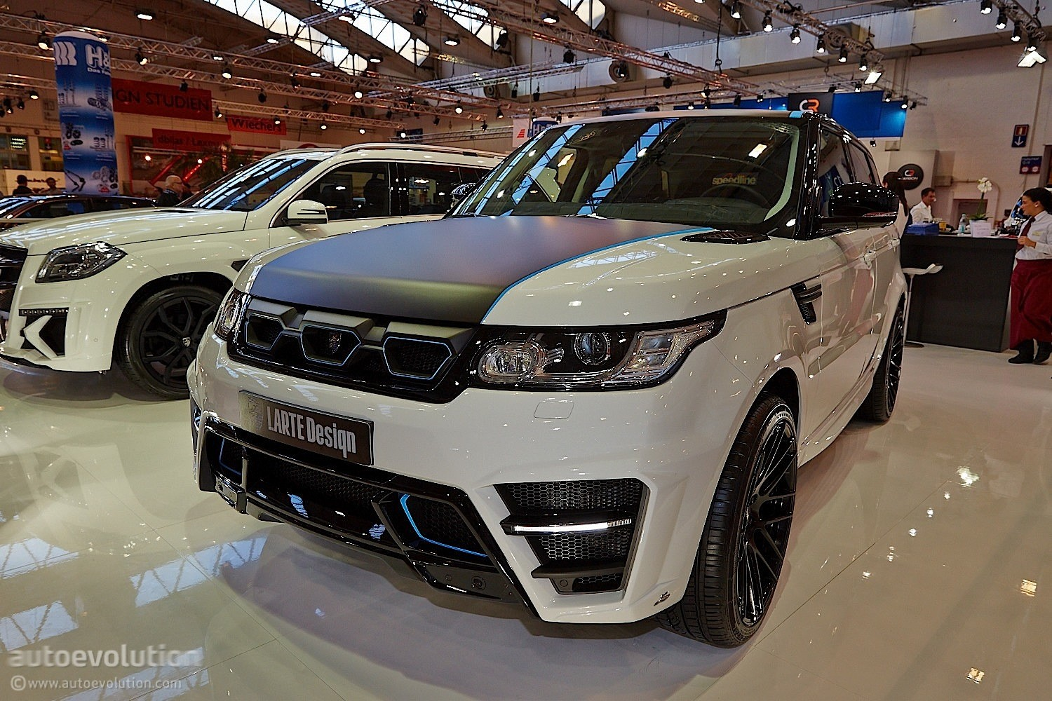 http://s1.cdn.autoevolution.com/images/news/gallery/larthe-design-range-rover-sport-looks-like-its-been-drilled-essen-2014-live-photos_1.jpg