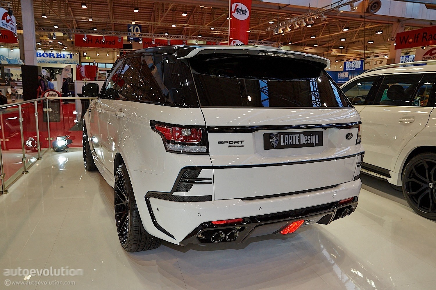 http://s1.cdn.autoevolution.com/images/news/gallery/larthe-design-range-rover-sport-looks-like-its-been-drilled-essen-2014-live-photos_4.jpg
