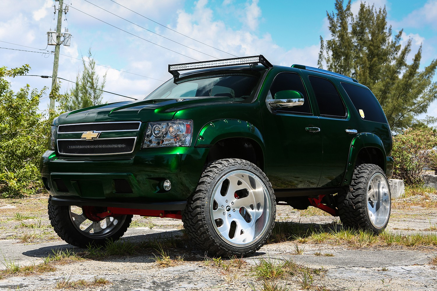 lifted chevy taho rides on forgiatos  looks fresh in green