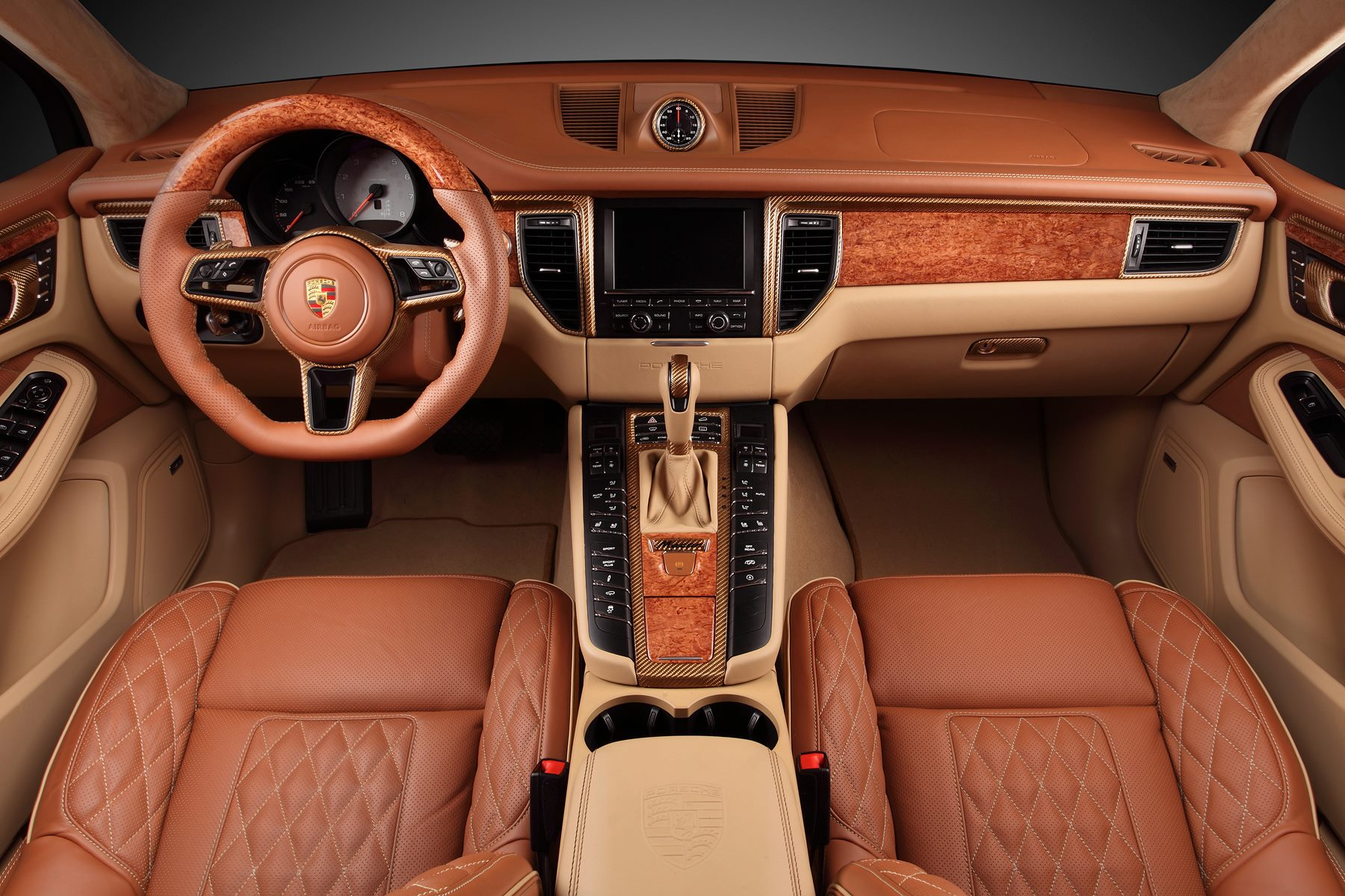 Wood Interior Car macan ursatopcar has gold-colored carbon fiber and wood