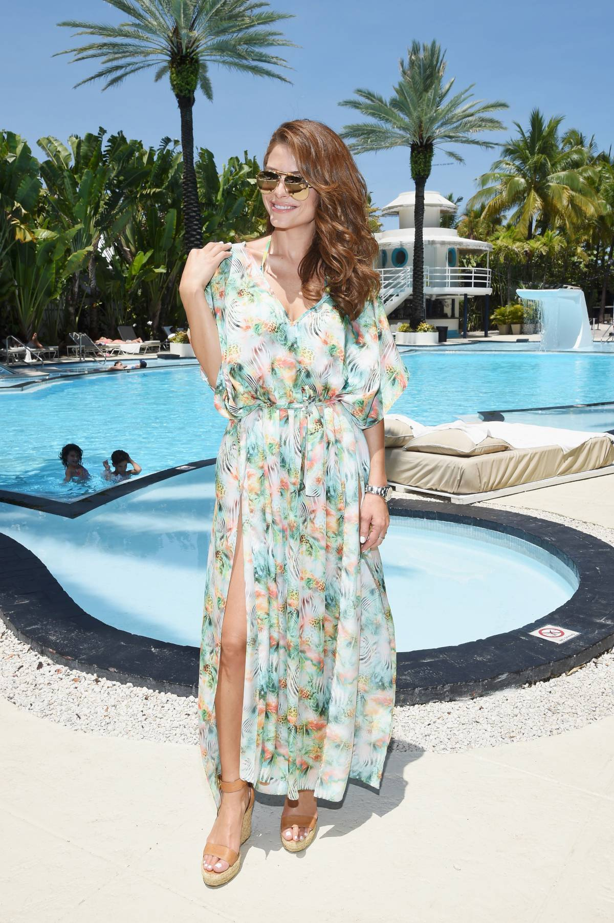 Maria Menounos Wears Tropical Dress Next To An Exotic
