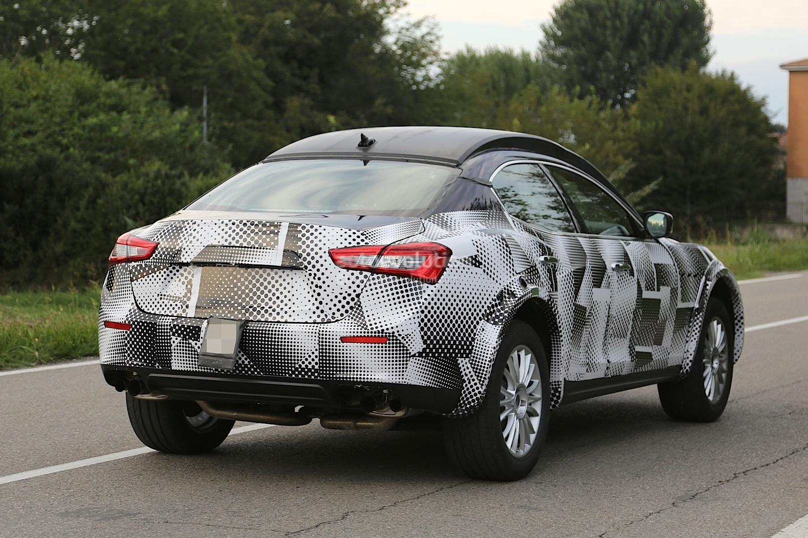 Maserati Levante Suv Spied Hiding As Lifted Ghibli