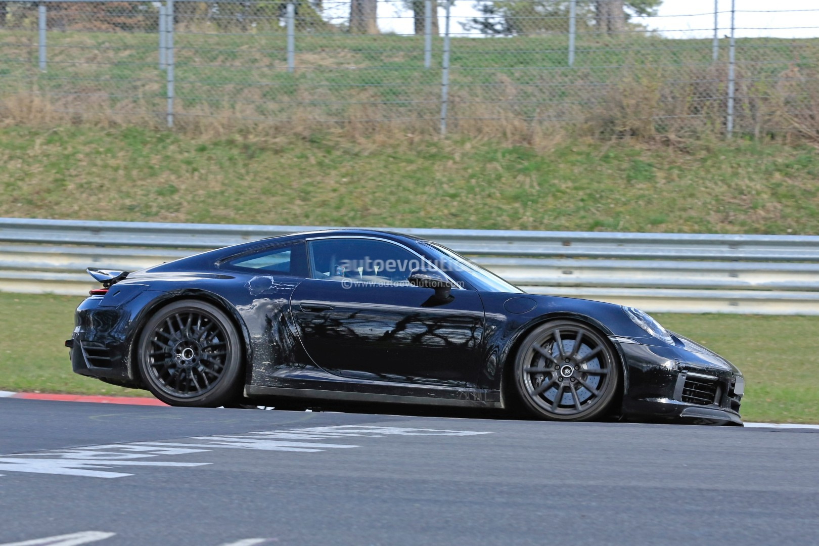 new 2019 porsche 911 makes nurburgring debut prototype could be a hybrid autoevolution. Black Bedroom Furniture Sets. Home Design Ideas