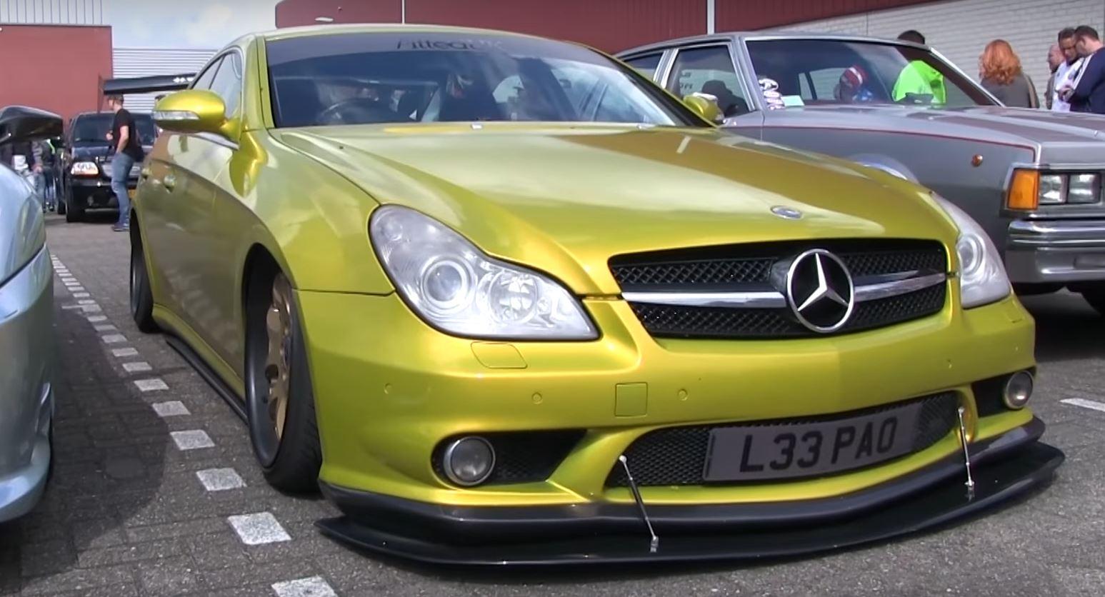 Old mercedes benz cls55 amg has crazy huge wing for Mercedes benz cls55