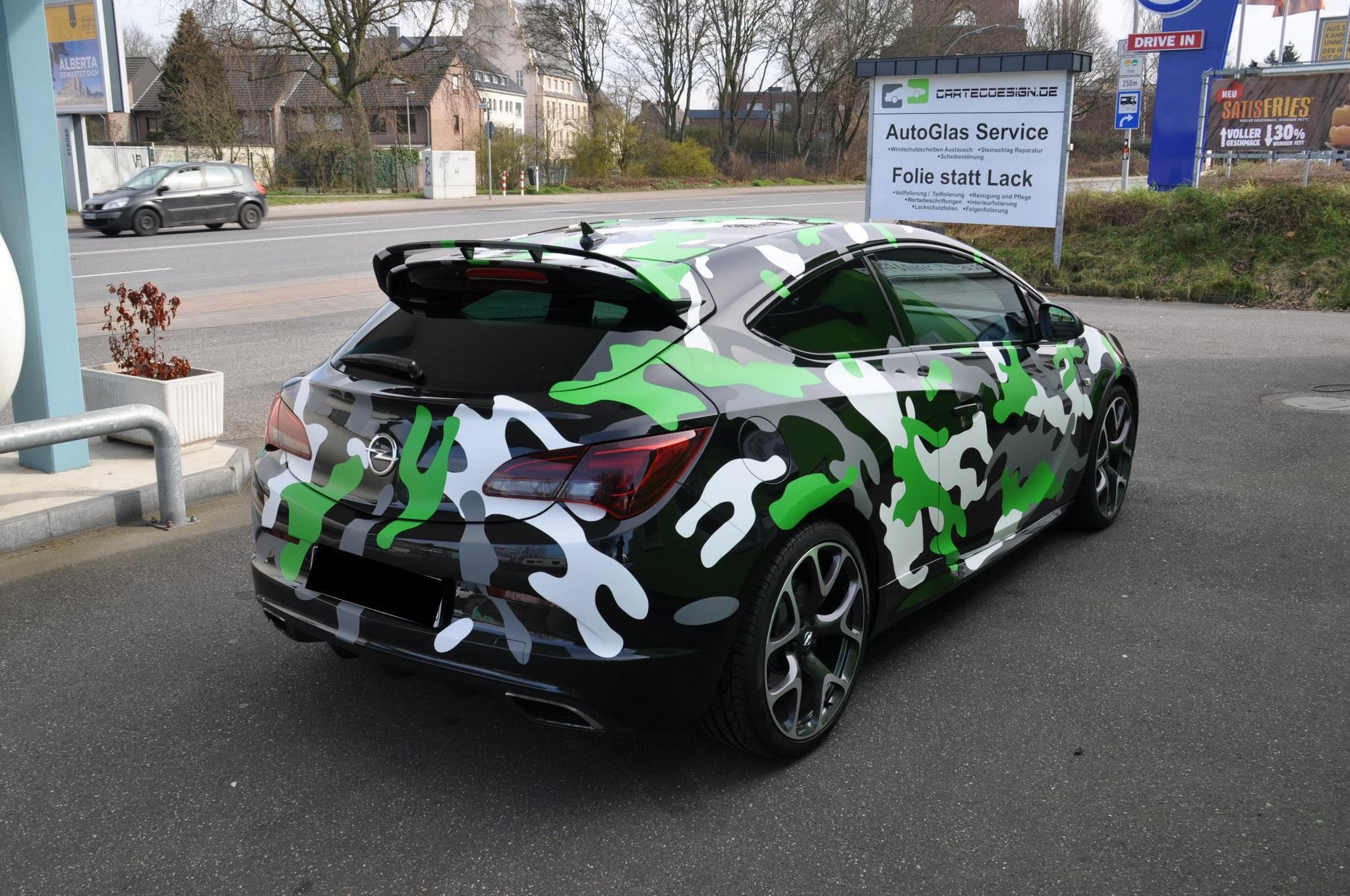 Opel Astra OPC In Camo Wrap Looks Tough Autoevolution