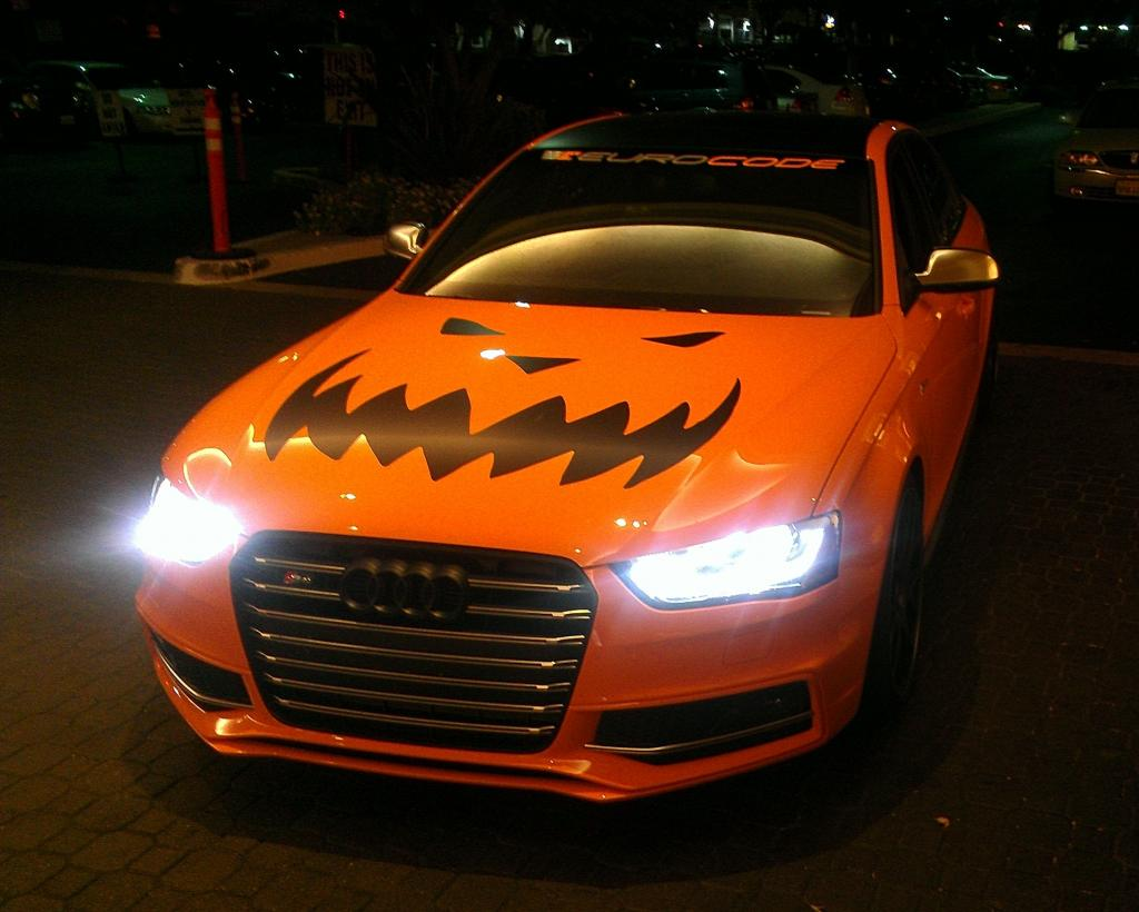 Orange supercar duo goes trick or treating with halloween for Car picture ideas