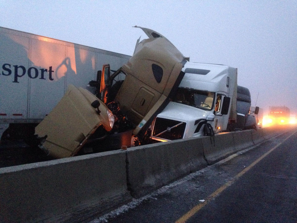 Pickup Driver Survives Being Crushed Between 2 Semis in I-84 Pileup