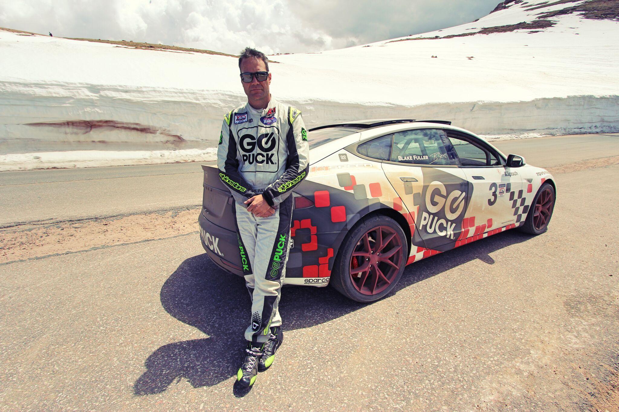 blake fuller and his tesla model s p90 racing car at pikes peak