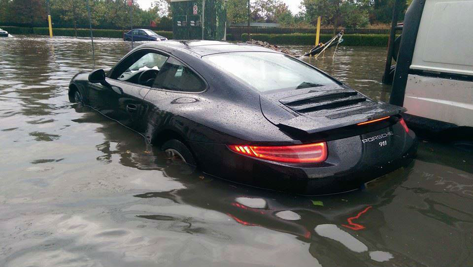 Porsche 911 Caught By The Flood Drowns In Muddy Water