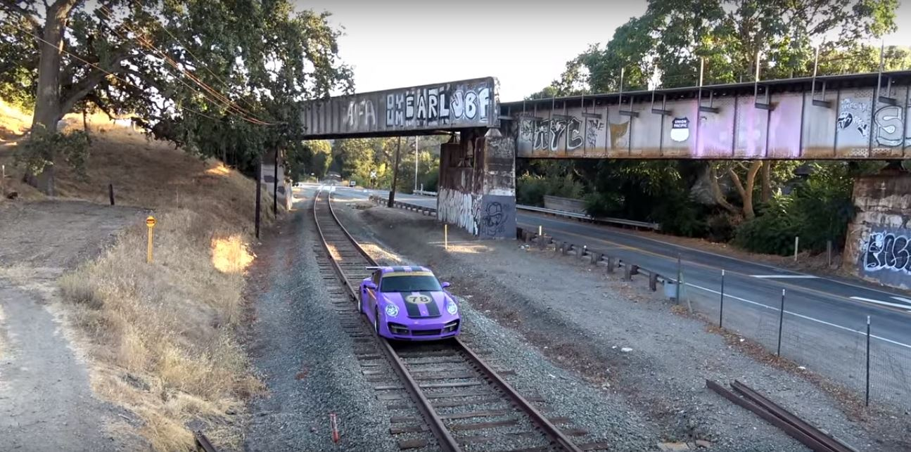 Porsche 911 Turbo Driven On Train Tracks Is A Really Bad