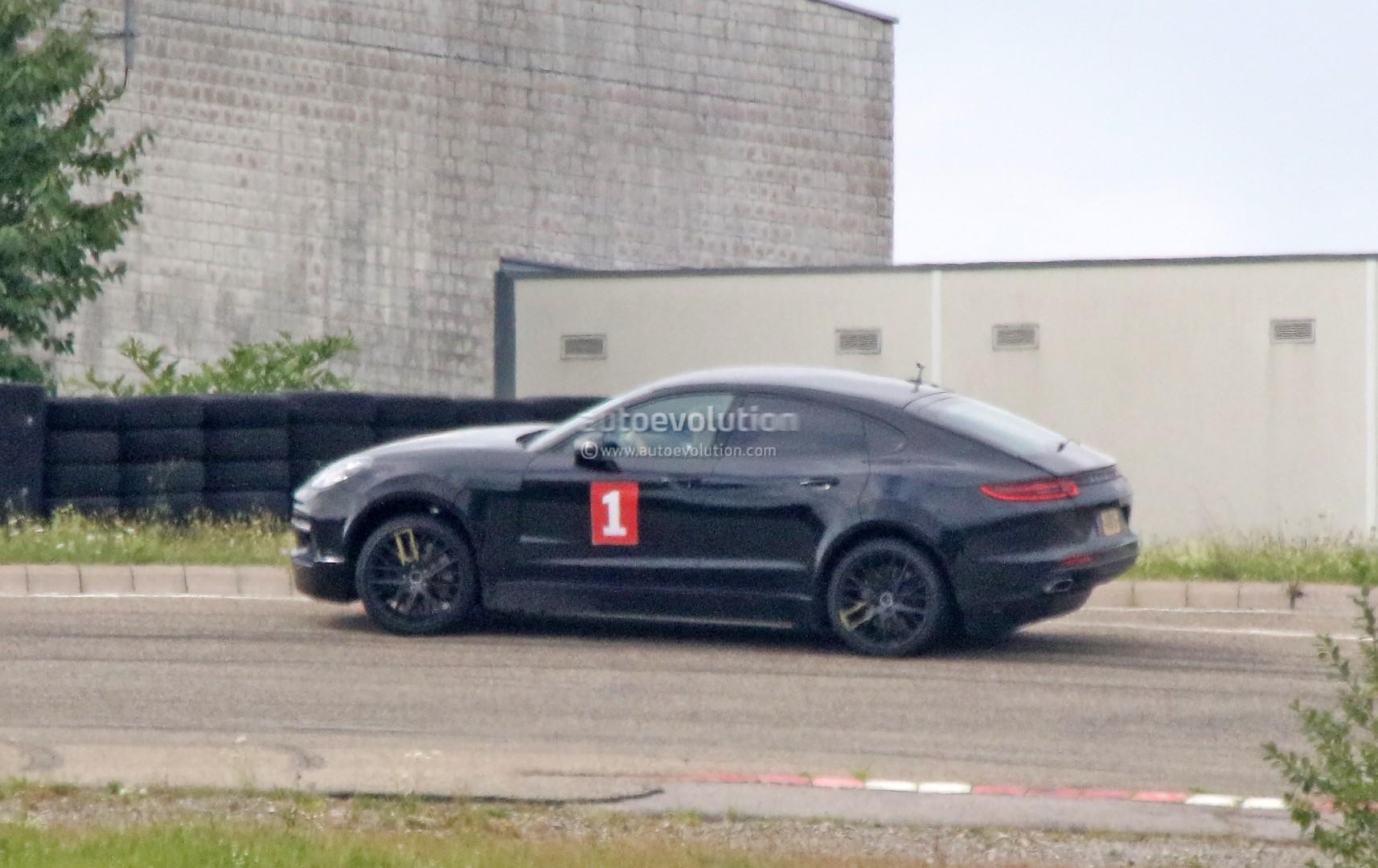 porsche-sahara-suv-coupe-makes-spyshot-debut-as-lifted-panamera-test-car_6