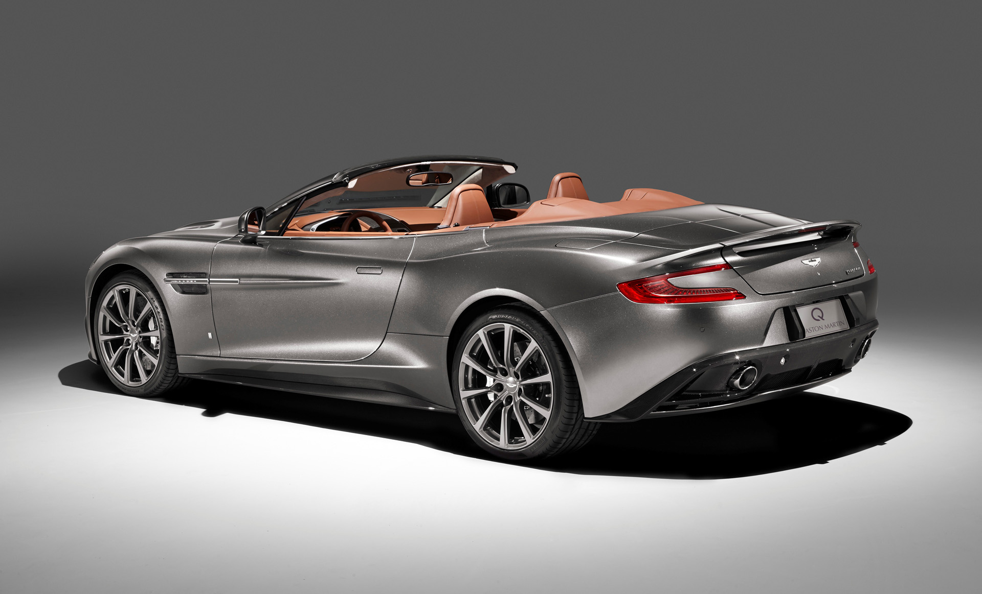 q by aston martin showing four new models at pebble beach. Black Bedroom Furniture Sets. Home Design Ideas
