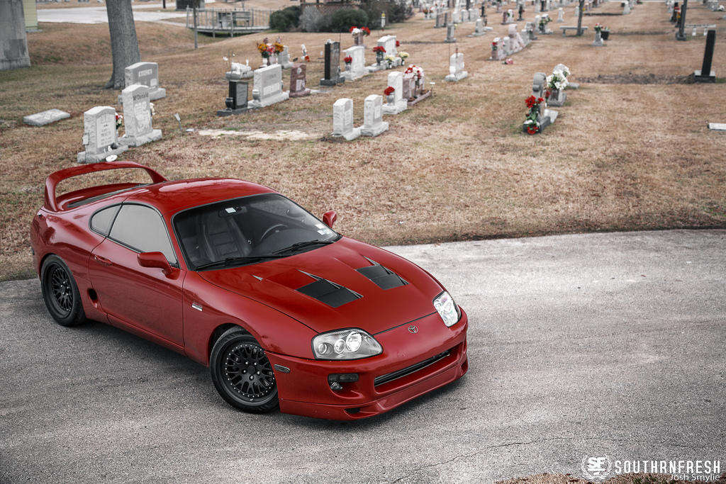 Renaissance Red Toyota Supra Posing In A Weird Location