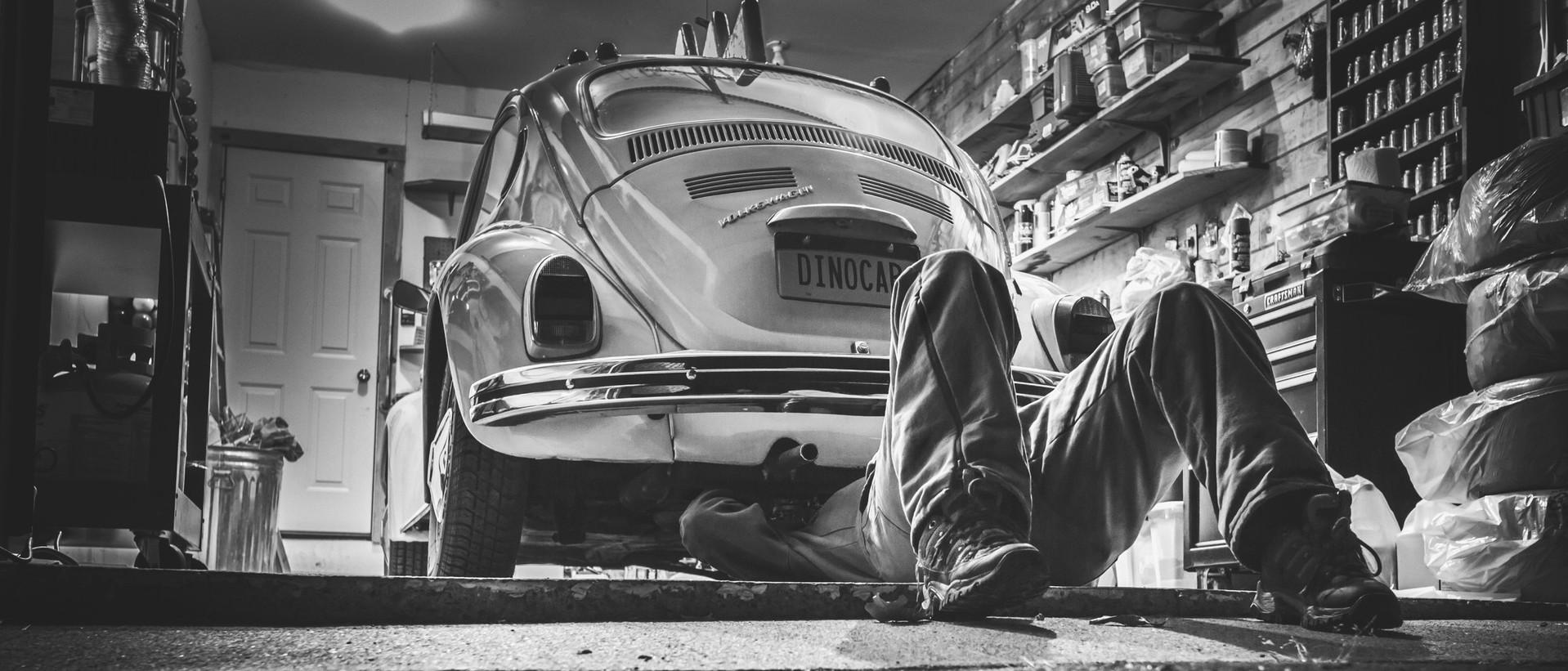 Man Working On Volkswagen Beetle
