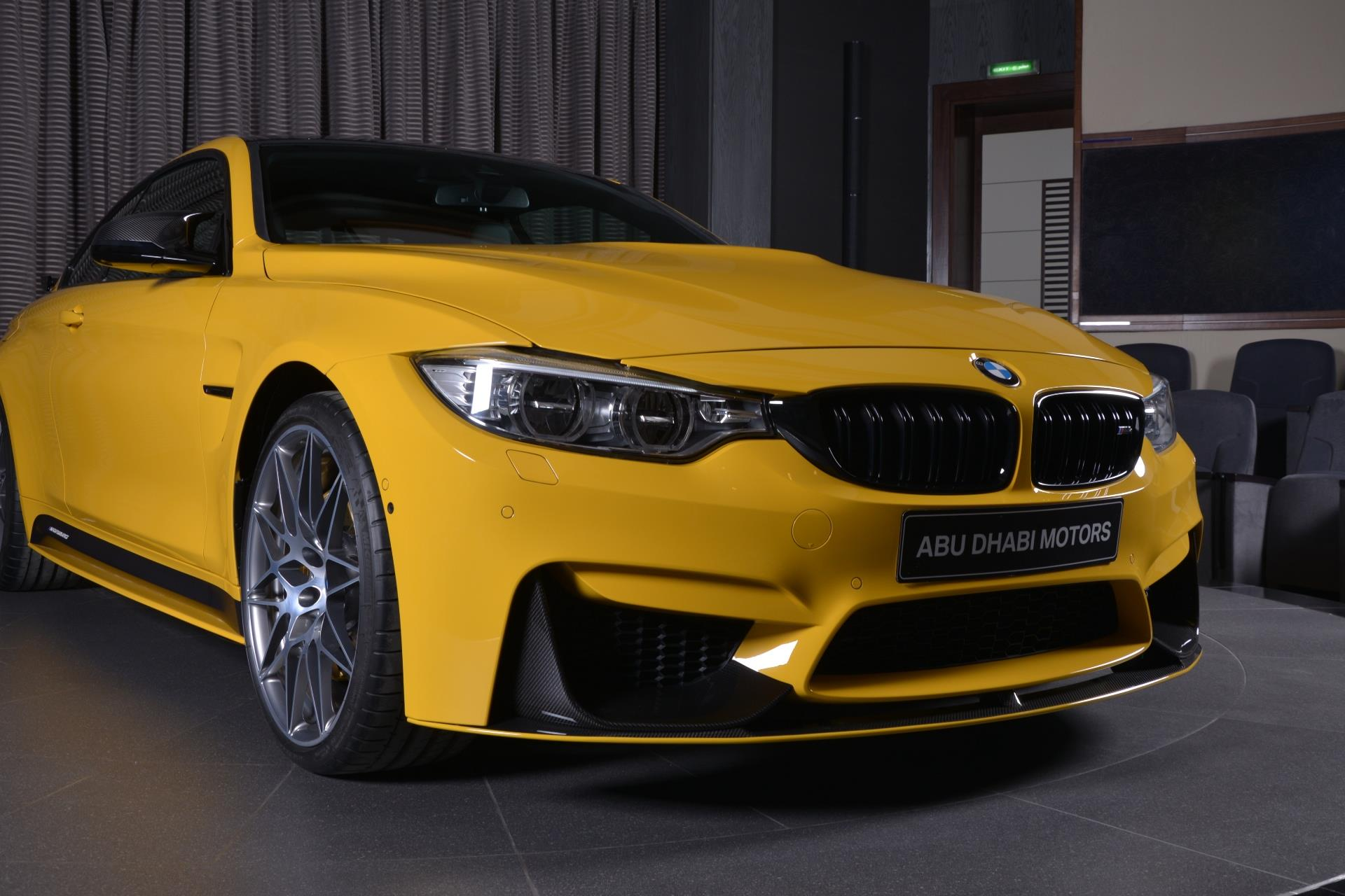 speed yellow bmw m4 competition pack has carbon kit in abu. Black Bedroom Furniture Sets. Home Design Ideas