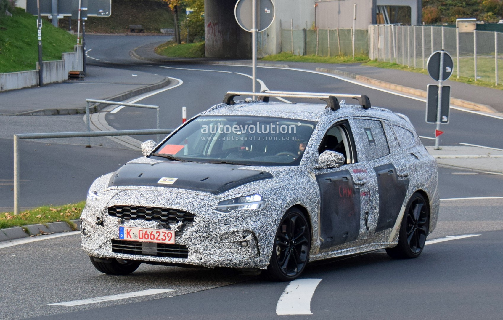 spyshots  2019 ford focus st wagon reveals volvo-inspired headlights